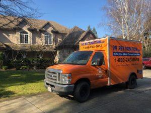 Water Damage Restoration Rear Of Van At Residential Job